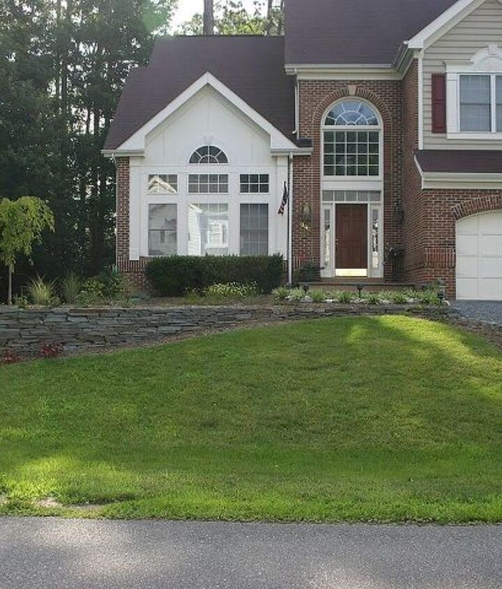 We added this colonial stack stone wall and landscaping.