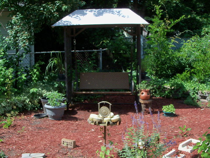 love my swing surrounded by great smelling herbs and grasses
