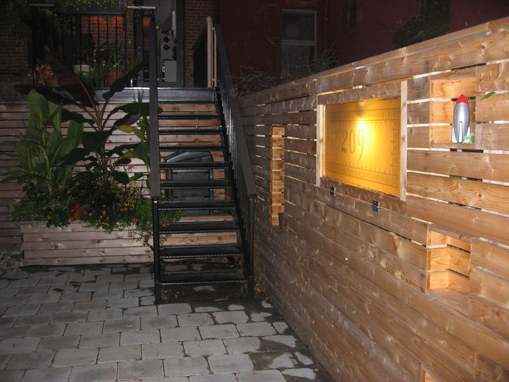 Cubbies light up at night.  Glass in fence is transom that was above front door.