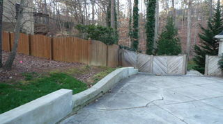 q i really want to remove part of the retaining wall, concrete masonry, fences, outdoor living, Wood fence is neighbors base being about 3 above my driveway