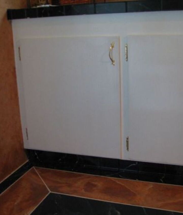 cabinets where white just received a new coat of paint. It was needed.