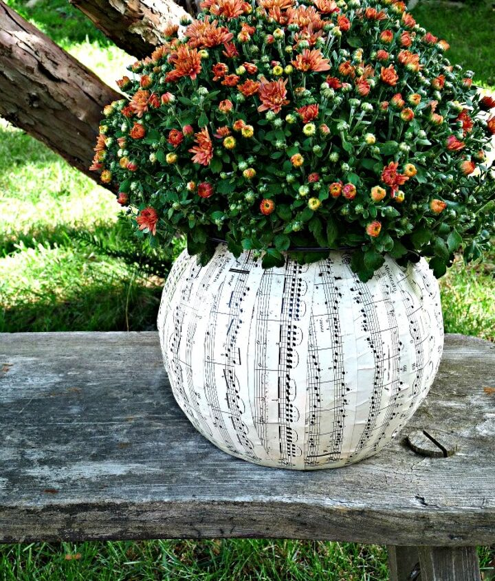 Turn an ugly plastic pumpkin into this music sheet planter!   http://eclecticallyvintage.com/2012/09/1-pumpkin-music-sheet-planter/