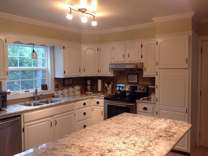 the after...hood range in and loving the sand color on the walls, white cabinets and a mocha color as the backsplash.