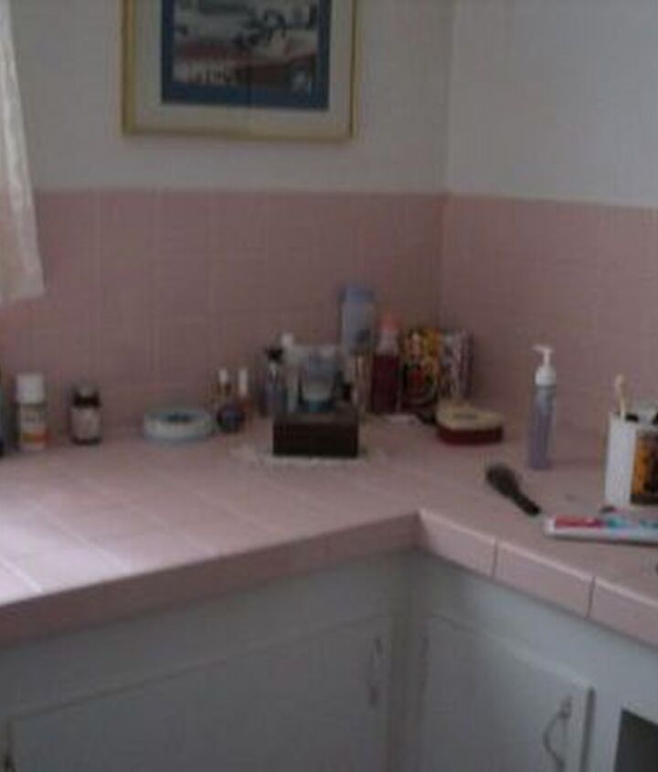 Pink tile counter top and partly up the wall.
