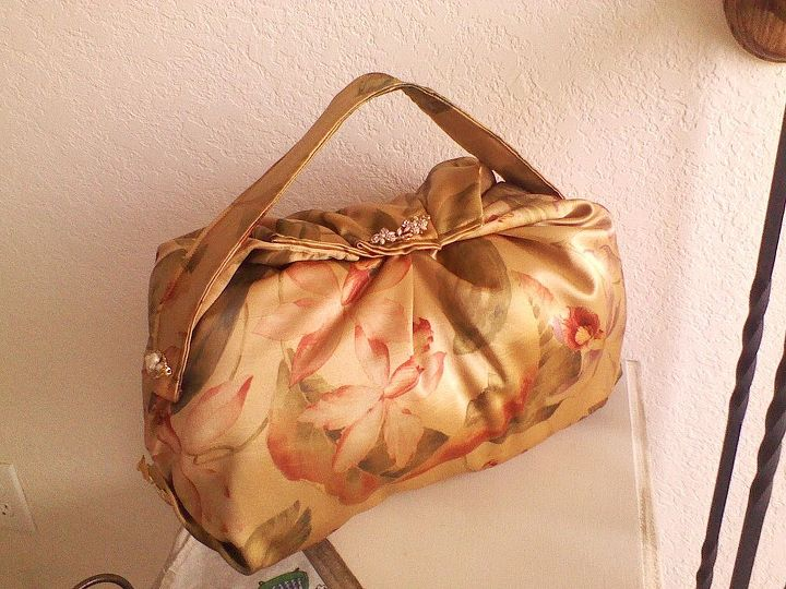 This was a curtain I think, and made a purse pillow with some old jewelry for accents.