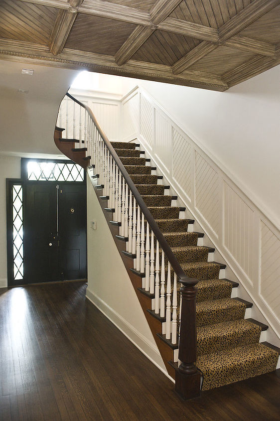 Refinished floors and woodwork in the main hallway, with the addition of custom beadboard.