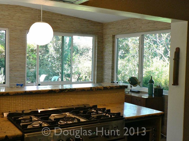 A new layout means cooking looking out big windows to the backyard rather at a wall.
