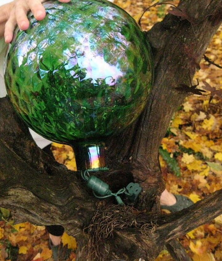 Lights all inserted into the INSIDE of the gazing ball. This is how the ball will sit in the crook of the log.