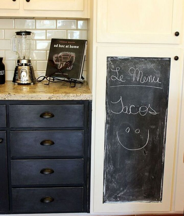 Changing out knobs to pulls changed the en tire look of the drawers.  Painting one of the panels of my Pantry cabinet with chalkboard paint gives a warm feel and breaks up the white.