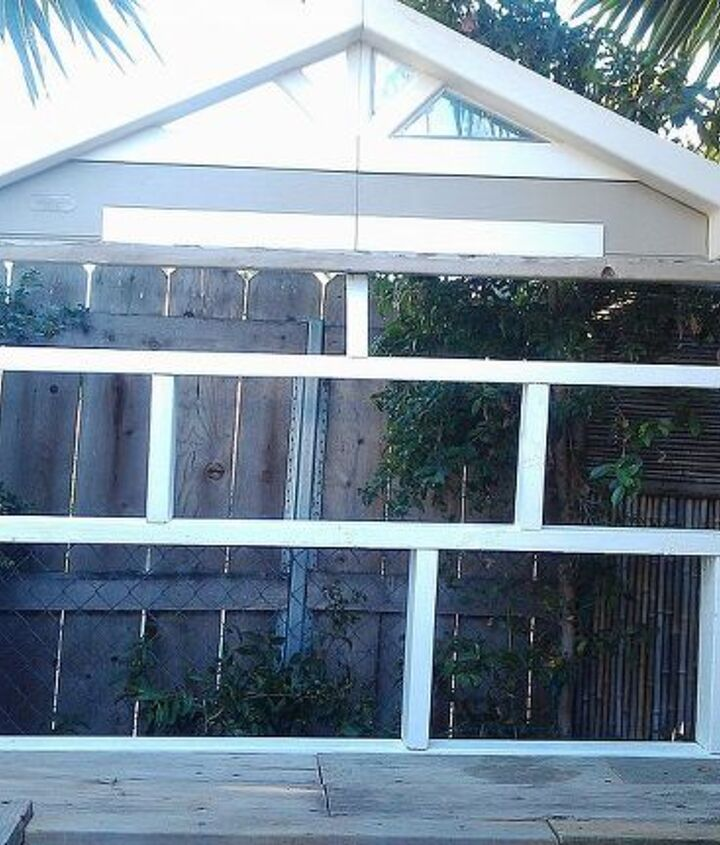 """I built a wall of shelves out of discarded 2x4 pieces I found in a wood pile.  The  plastic  """"window"""" on top is a replacement window to my aviary which this table butts up next to on the left. It ties the areas together."""