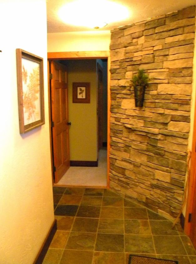 The entry way boasted a beautiful stone wall.
