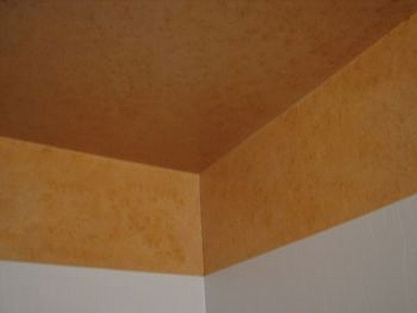Sponged faux finished on the ceiling using raw Sienna and raw umber along with white acrylics and glaze of course.
