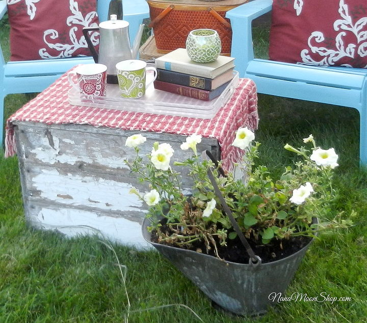 I used an old coal bucket to plant my yellow petunias and an old wooden box with chippy paint as a coffee table.