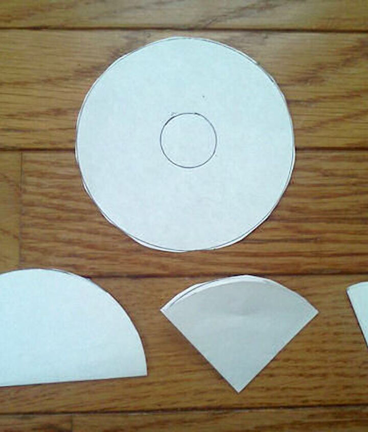 Cut the circles out,. Fold in half three times.