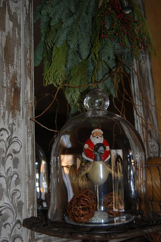Glass dome covering another Lori Mitchell Santa!