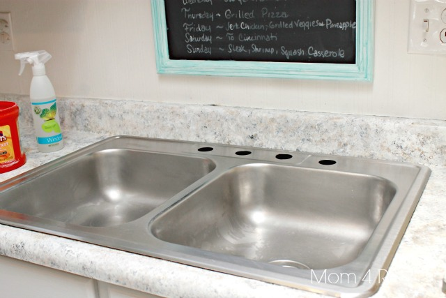 Remove your old faucet.  Turn off water supply and unhook hoses.