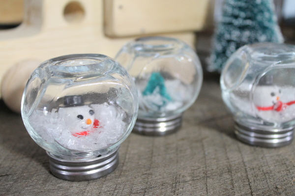 These mini cruets make the cutest little snow globes!  http://www.craftsunleashed.com/index.php/seasonal/homemade-snow-globes/
