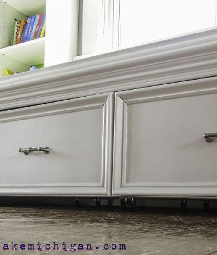 A close up of the finished drawers, painted white with bushed nickel hardware.