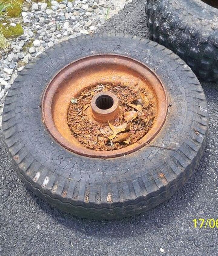 the leopart tire planter, gardening, repurposing upcycling, See all the crackling and crazing in the rubber