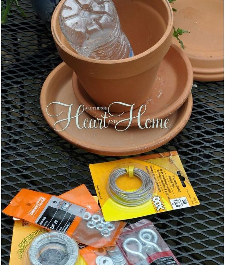 "Gather these easy to find supplies: Terra Cotta Pot, Saucers, Picture Hanging Wire, 5"" Eye Bolt,2 Nuts, Fishing Swivel, Branch  & a water bottle! Soak your terra cotta in water over night to make drilling the holes easier..."