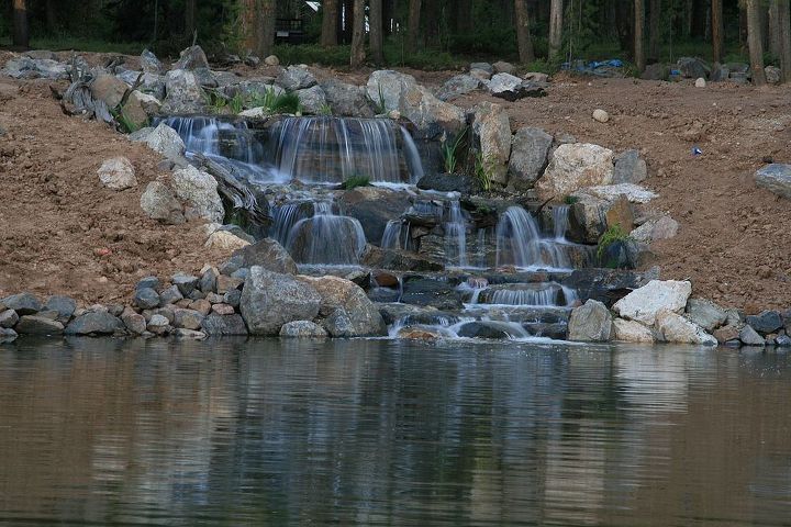 A perfect spot for a family picnic!  Adding waterfalls to the lake ensures there will be oxygen added to the water and a healthy ecosystem is guaranteed.