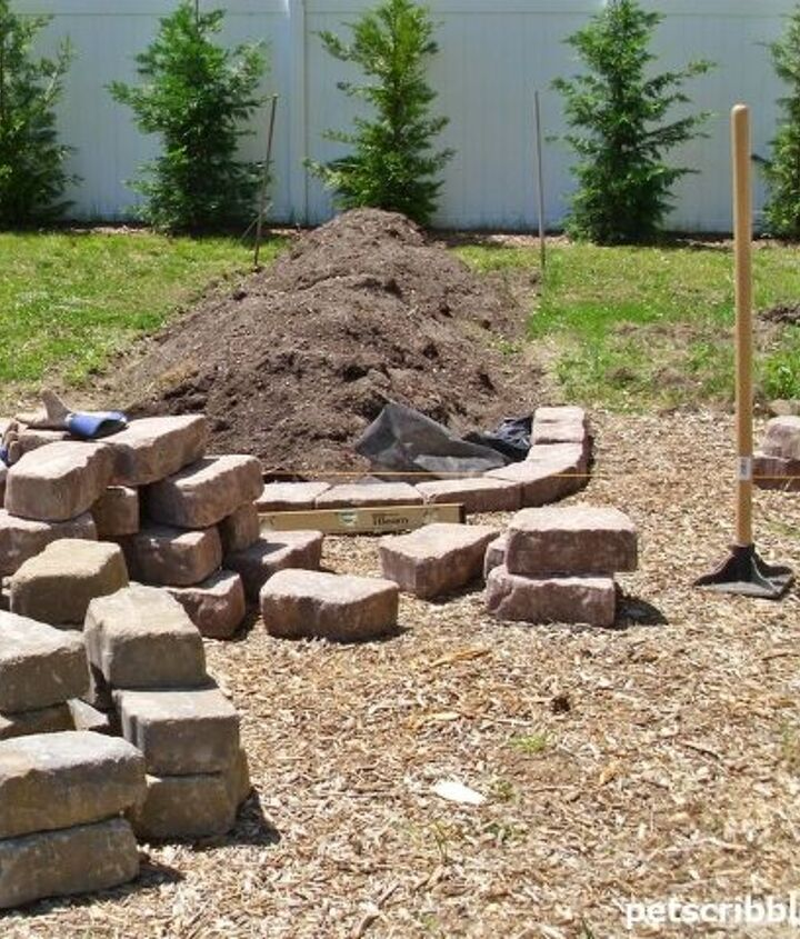 Laying out the stones with some landscape fabric, after tamping down the ground.