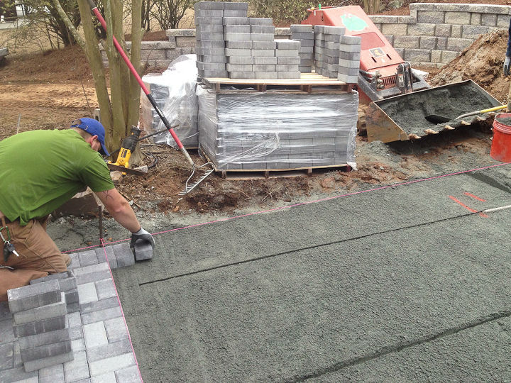 Here you can see where the sand was screeded and the pipes slid down. Since you can only fill what you can reach, it is easiest to fill as you lay pavers. You can see 2 strings set up as guides.