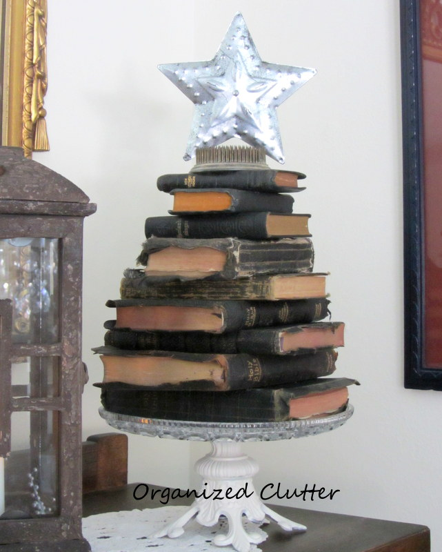 a nativity set a stacked bible christmas tree christmas decorations repurposing upcycling seasonal