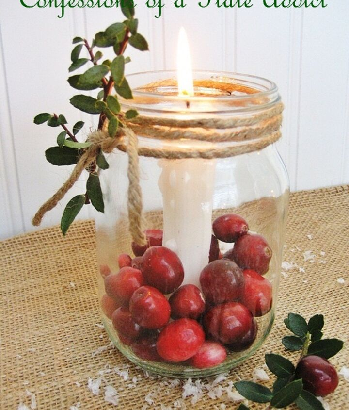 fun and easy christmas mason jar candles, christmas decorations, seasonal holiday decor, Just anchor a candle inside a Mason jar using candle wax or wax buttons Then add fresh cranberries and wrap jute twine around the rim Add a sprig of boxwood for a festive touch