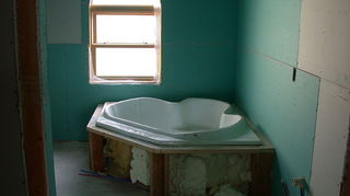 q i want to retile my bathroom after taking down the old tile around the tub if the, bathroom ideas, tiling, Here s greenboard around a tub If the walls were to be tiled you d want to replace those parts with Hardibacker board