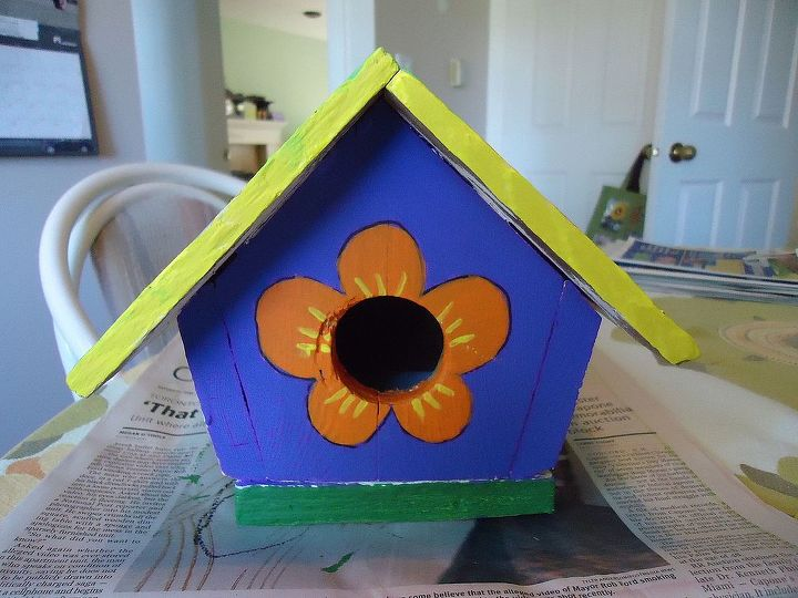 I added the flower petals for a touch of whimsy and painted them orange. I decided the pale yellow trim wasn't right so I redid the tum with a brighter yellow.