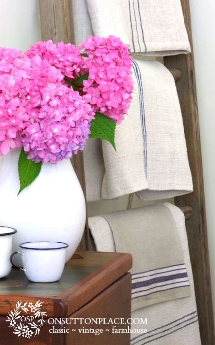 Ann of On Sutton Place features a beautiful metal pitcher filled with bright blooms.