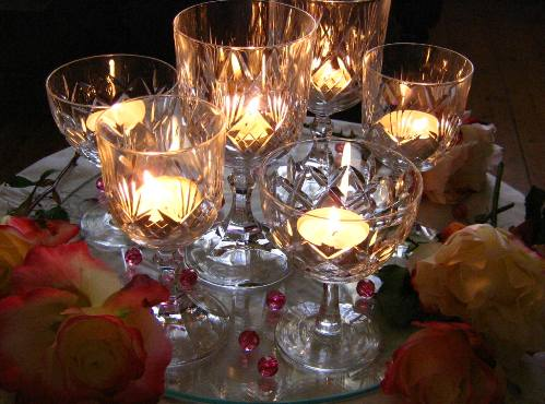 Just another take on wine glasses as tea light holders.