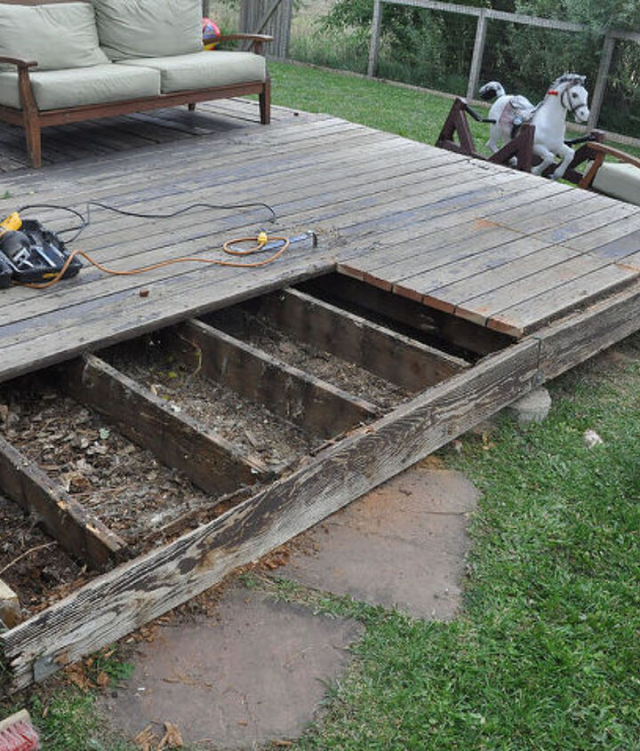 deck removal begins...note the rot in the rim joists