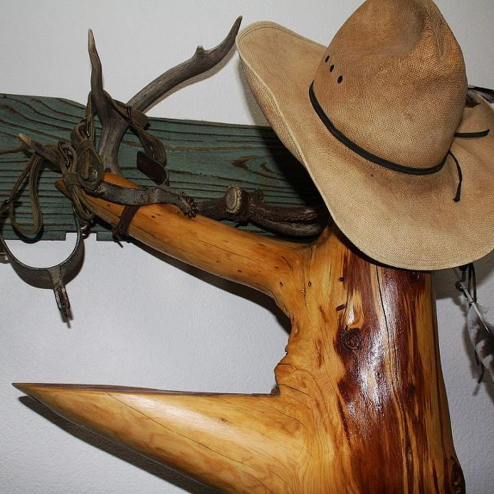 Old barn wood, antlers, spurs and a much loved hat hang out with this beauty.