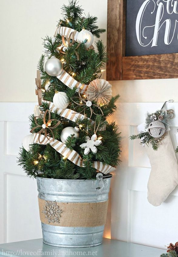 I've had this tree since my oldest was just a baby. I used to put it in his nursery, but have since upgraded both of our boys to full size trees. I decorated the tree in a neutral color scheme & added it to the vignette.