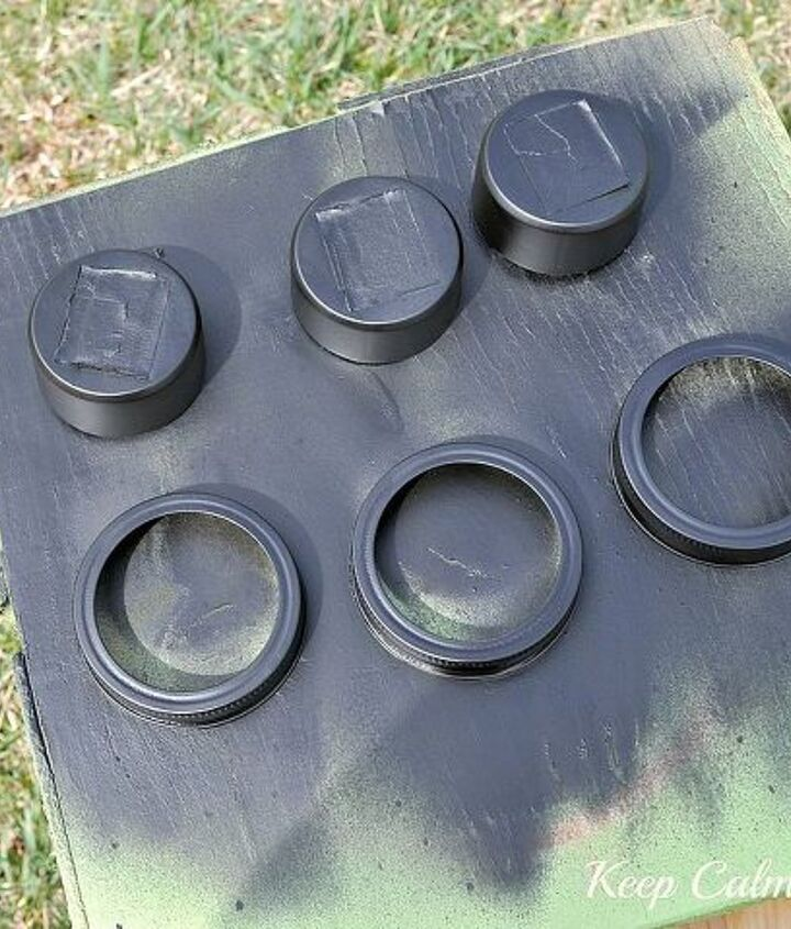Spray paint the solar light tops and lids.