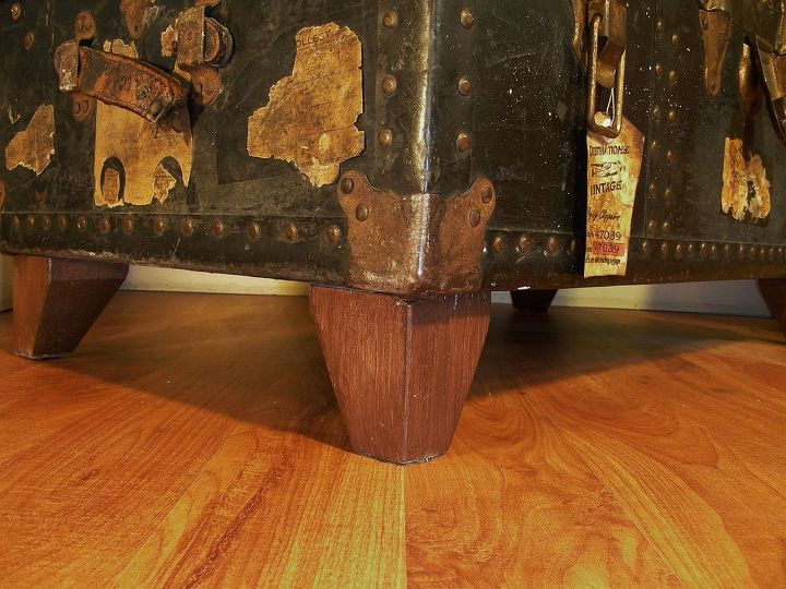 The faux hardwood finish on the new feet is just brown paint thinned with a tiny bit of water.
