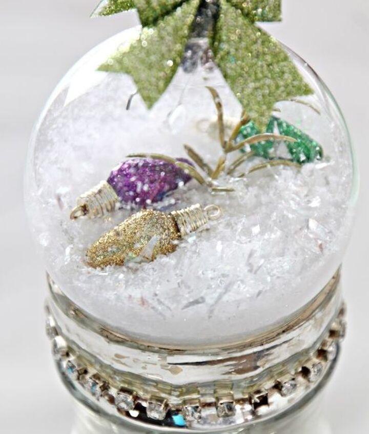 Snow globes on mercury glass.
