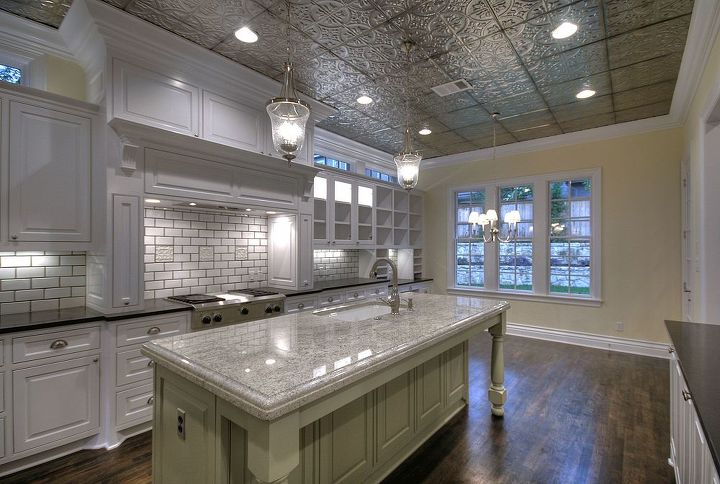 Tin ceilings are a great way to brighten up a kitchen.