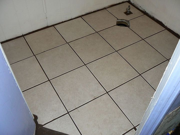 Walls repainted and tile set.