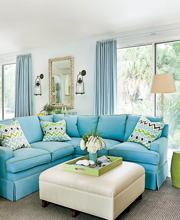 An abundance of blue appears prominently on pillows and walls while rugs and upholstered furniture keep things calm and clean. Shop the living room > http://wayfair.ly/10Ayrkf