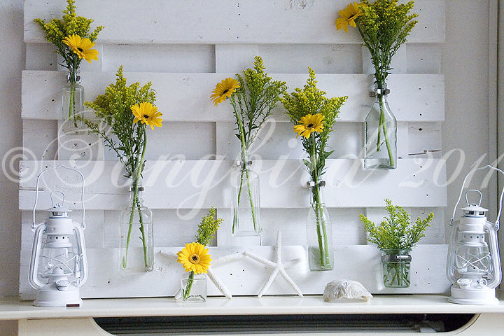 lots of variations possible with this pallet wood mantel decor, diy, home decor, how to, pallet, repurposing upcycling, With bright yellow flowers the mantel looked totally different