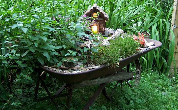 Planting the fairy garden with the grand kids was such fun!!!! We added electricity to their fairy house.