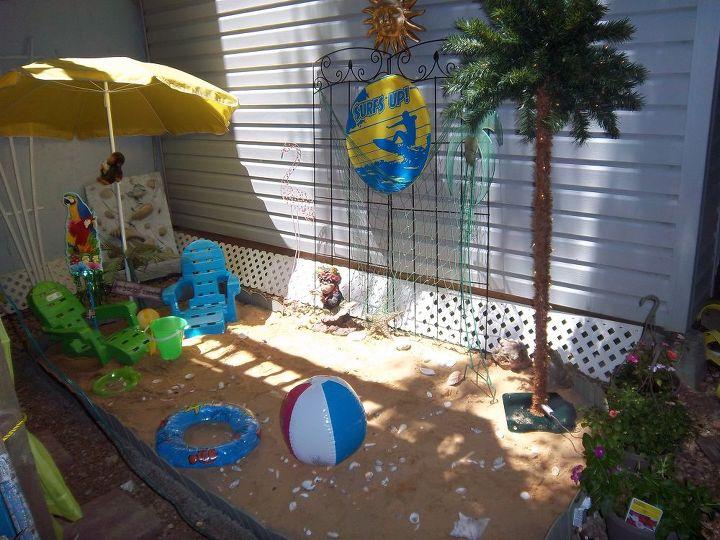 "mini beach next to ""under the deck"""