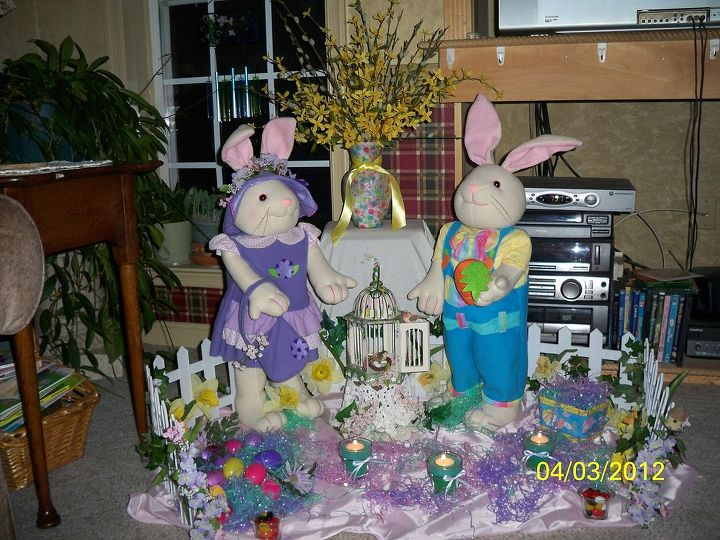 . . . . .hoppin' down the bunny trail!!  An old plastic fence worked just fine for this display. I NEVER throw out old silk flowers when re-doing wreaths or floral designs. No matter how faded or bedraggeled they may seem, they can always be reused somehow!!