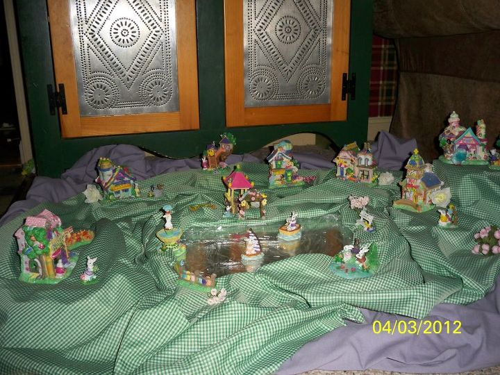 My grand daughter's mini Easter Village. A Mirror is used to create a pond effect. Some cling wrap was used to simulate ripples in the water (sort of)