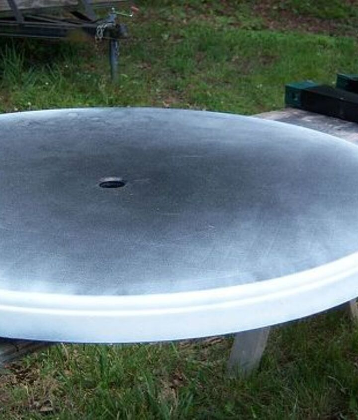 Started with a well used plastic patio table and spray-painted it white