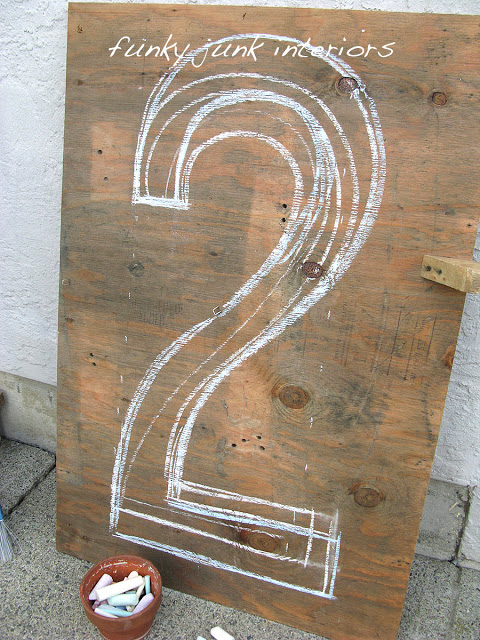 I started by sketching out my design on plywood with chalk, then cutting it out. More how-to is avail at the blog link.