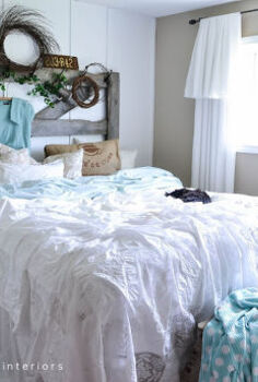 a horse gate and sawhorse for bedroom furniture, bedroom ideas, repurposing upcycling, A gate and sawhorse meant for outdoors share a life together indoors these days The bedding was created by throwing loose linens on top of a quilt Sheets were tucked in between the mattresses for a full length look How to is at